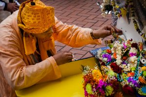 A devotee adjusting the children's version of the chariot