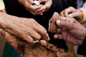 Breaking the coconut ceremony before the Festival start