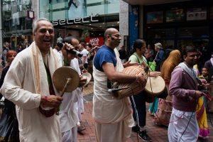 Musicians playing drums, tambourines and trumpets to accompamy the Ratha Yatra procession