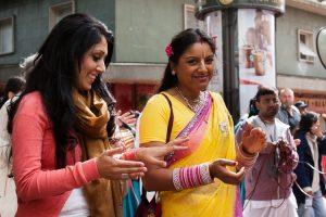 Hindu girls clapping at the Ratha Yatra festival
