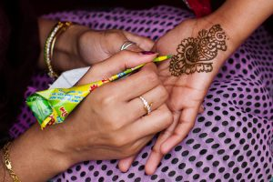 Hand henna painting at the festival stalls in Victoria Square, Birmingham