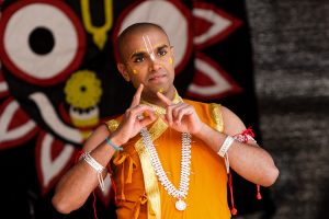 A dancer performs a traditional dance about young Krishna killing the demons