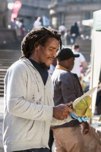 Young man preparing an exotic Caribbean fruit for sale