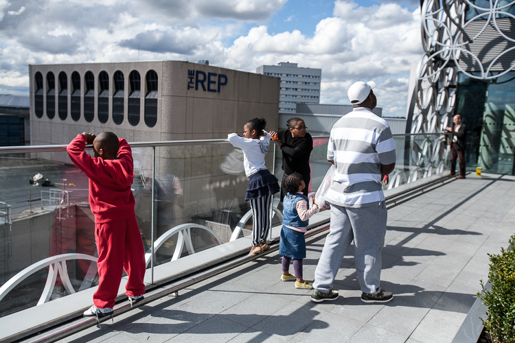 A Birmingham family enjoys a view from the Discovery Terrace