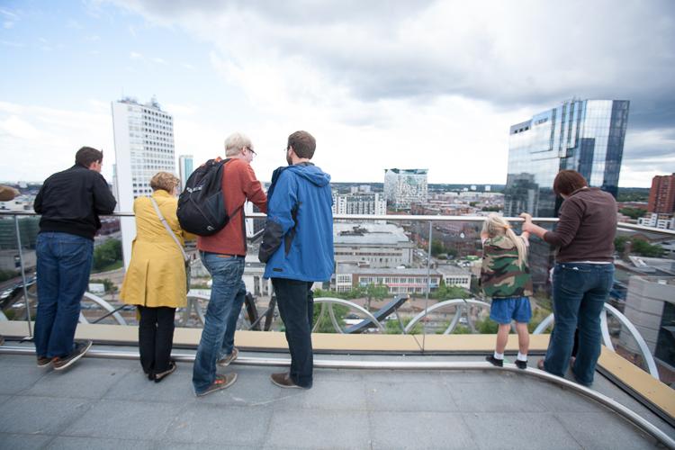 Library visitors looking at Birmingham vistas from the Secret Garden terrace
