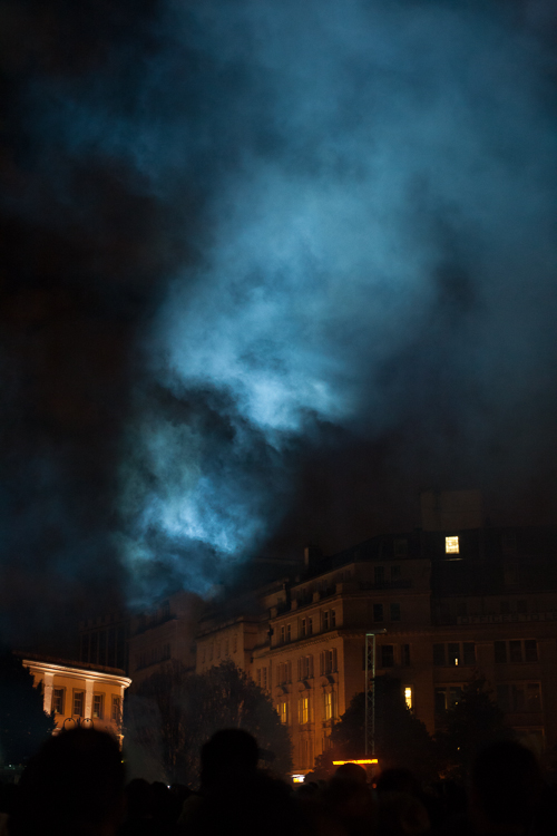 Smoke lit by powerful projectors at the start of !As The World Tipped' show