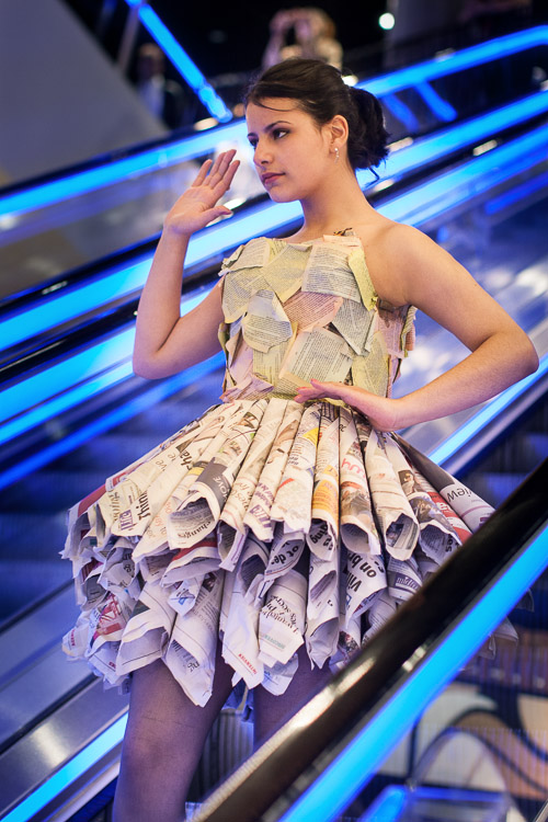 Paper dress with a full skirt made of rolled newspapers