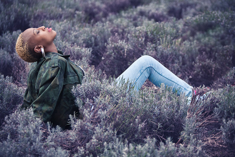 Model in the lavender field lit by afternoon  sun