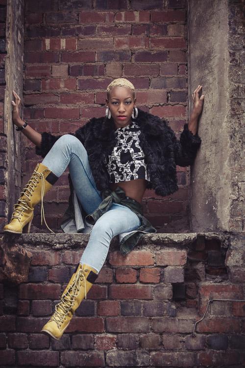 Model posing in a brick niche
