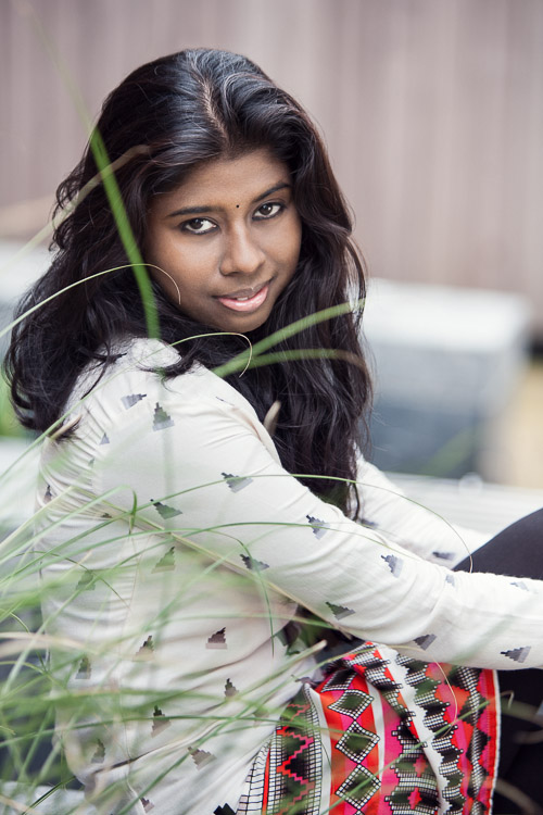 Urban portrait session at Church Street Square Colmore BirminghamThe blades of grass frame Minica's face and soften