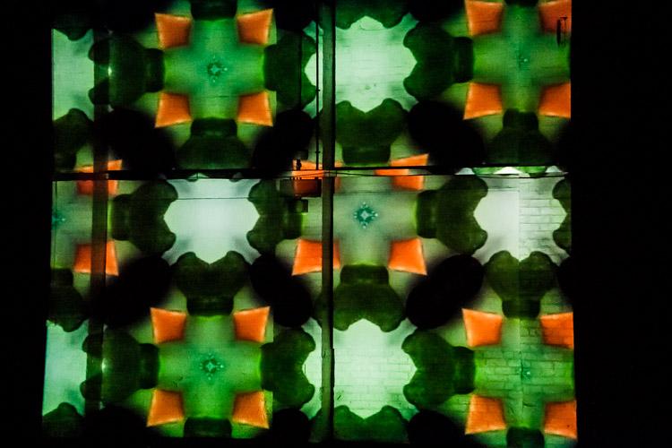 Illuminate - Kaleidoscope projection on the wall of Gallan car park