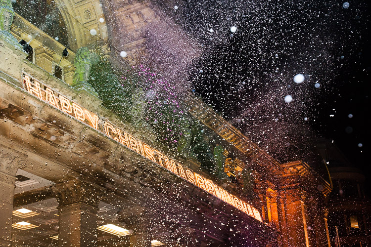 Birmingham Xmas Lights Switch On - a snow machine shoots snow from the balcony