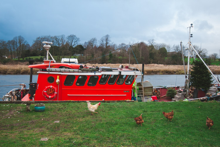Red boat permanently moored at Kingholm Quay Dumfries