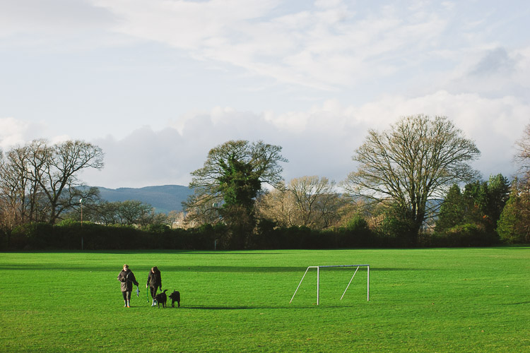 Dog walkers on the grounds of Crichton F.C.