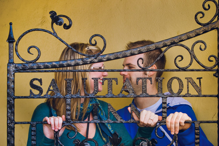 The gate metalwork is used as a compositional device in this couple's portrait