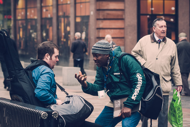 A musician chatting to a Greenpeace activist