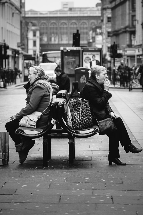 Two ladies - phoning and smoking - at Argyle Street Glasgow