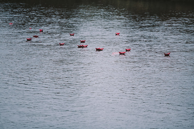 Paper boats floating down the Nith