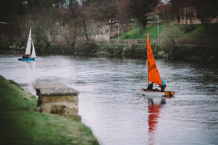 Sailboats on the River Nith along Dock Park