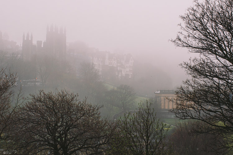 Mist wrapping the hill and descending on Princes Street Gardens