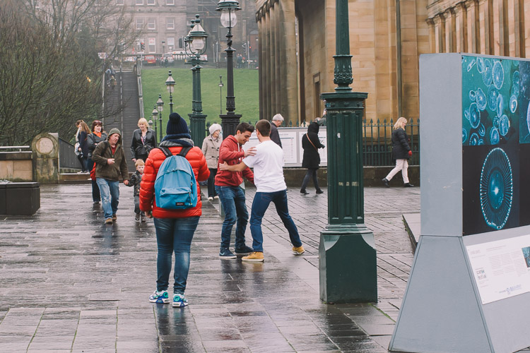 Teenagers trying to dance to the piper's tune amidst passers-by
