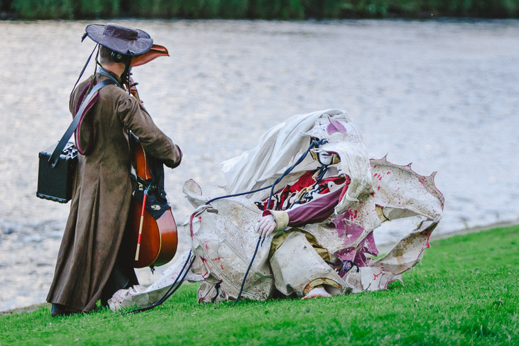 The characters were rolling on the grass to the musician's tune