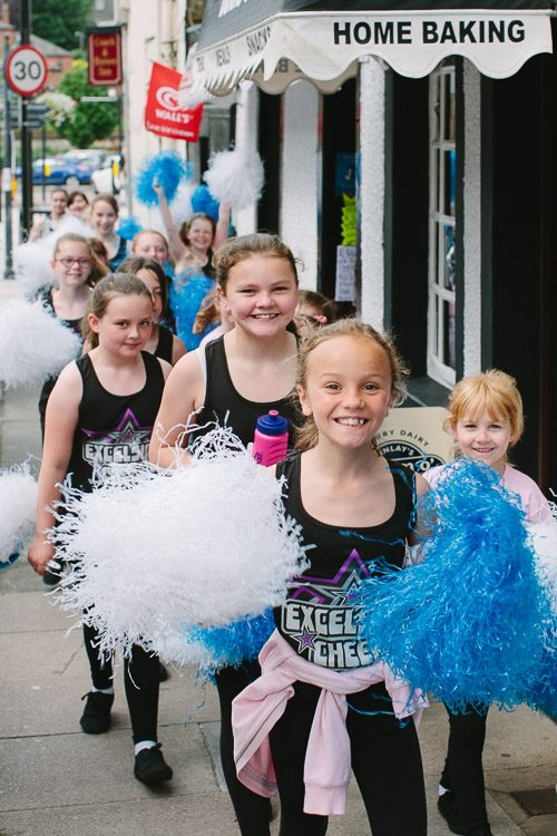 Cheer girls on their way to Midsteeple to greet Queen's Baton Relay