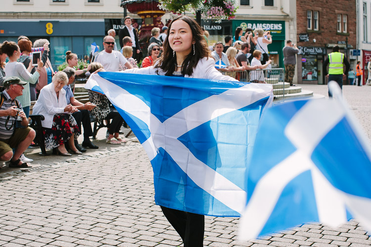 A girl carrying the Scottish flag for Queen's Baton Relay in Dumfries