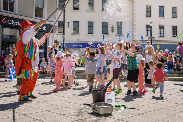 Children trying to catch soap bubbles