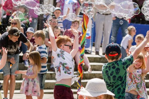 Children trying to catch soap bubbles photo