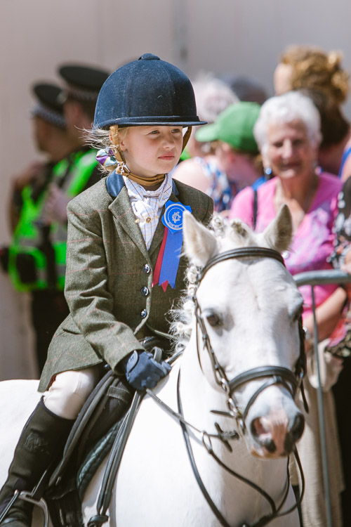 Younf girl riding a horse on Guid Nychburris day photo
