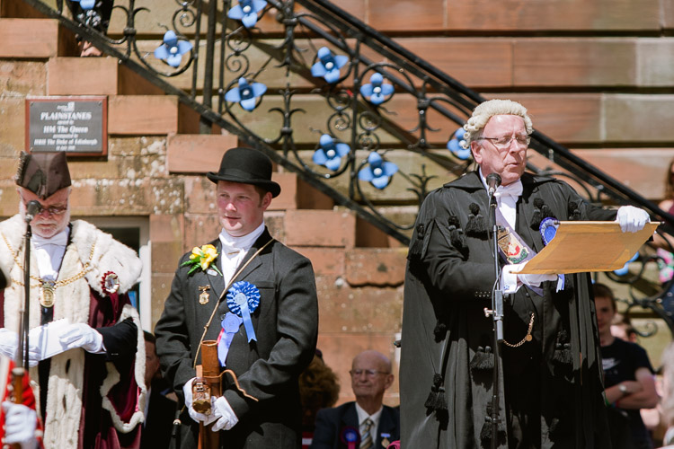 The clerk reads the Royal Charter of Dumfries