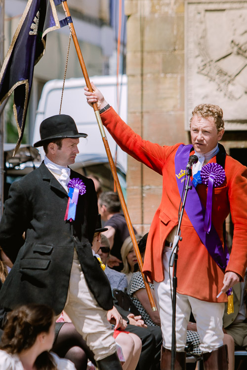 The Pursuivant demonstrates the flag of Dumfries to the people