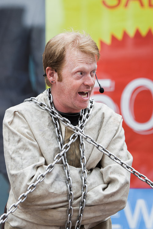 Todd Various cracking jokes in a straight jacket and chains