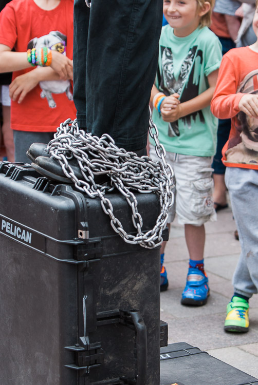 Chains fall to let a performer free in a Houdini escape routine - detail