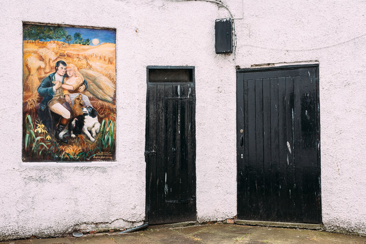 Robert Burns having 'a merry squeeze' in the field - a mural by local artist Josephine McSkimming