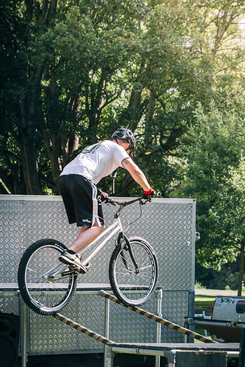 A member of 7Stanes bike display team hops up two rails