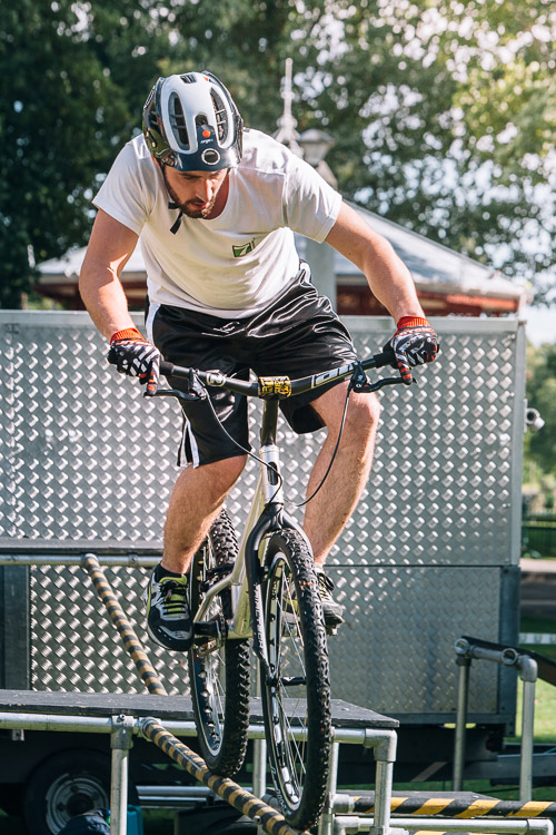 A bike ride down a thin rail