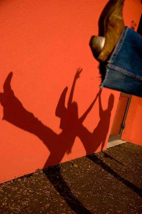 A shadow on bright red wall