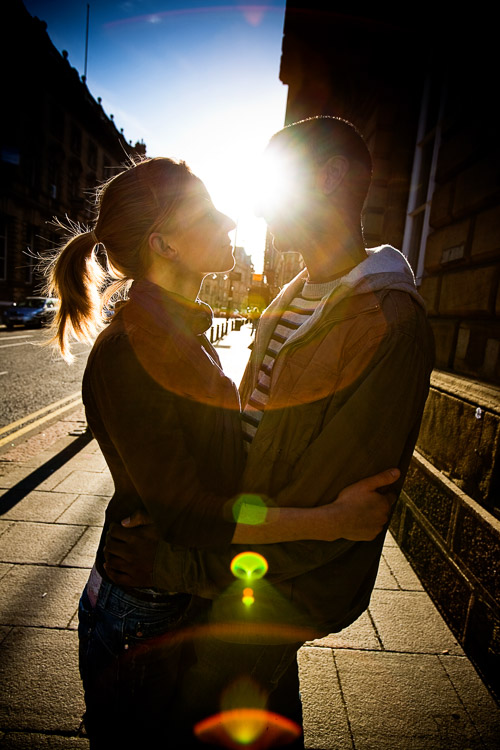 Sun flair parallel to the street line as urban portrait photography element
