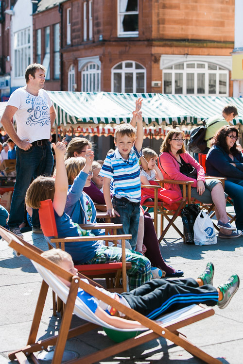 Young spectators volunteering to take part in magic demonstrations