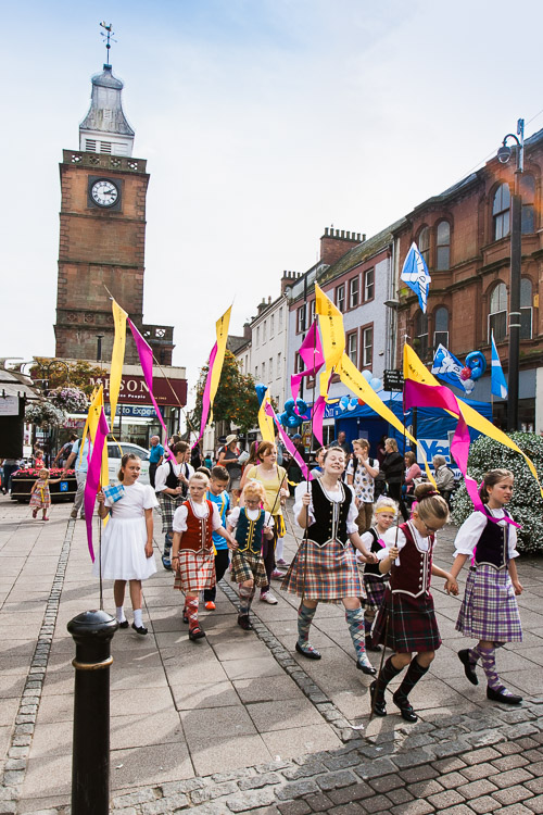 Ceilidh dancers carrying the Stove flags