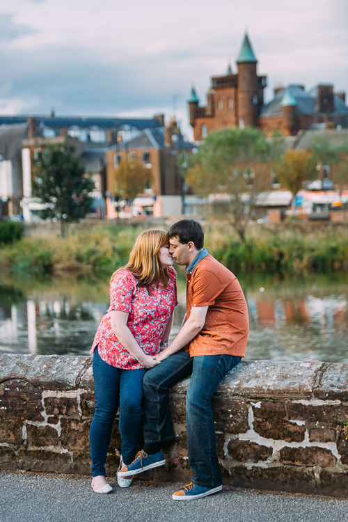 Couple portrait with Dumfries characteristic turrets at the background