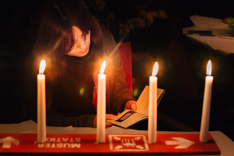 Reading the New Rules of Public Art in candle light