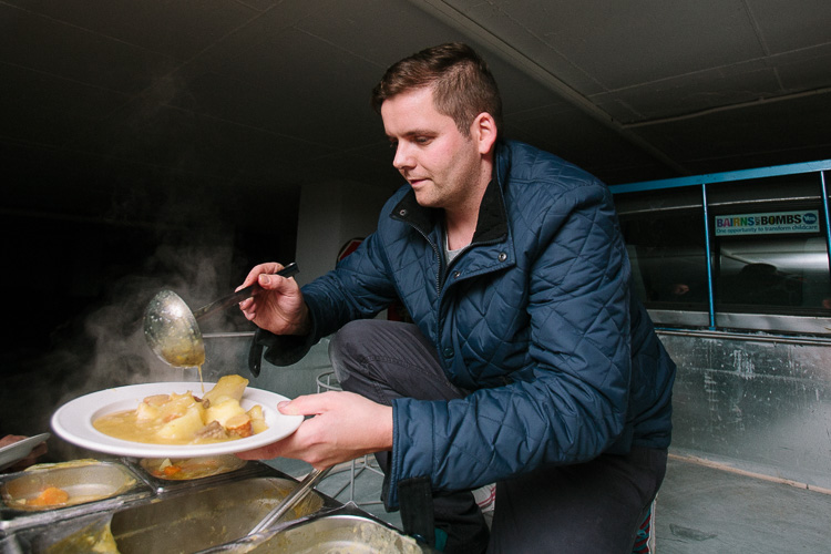 Craig Patterson from Burns Cafe serves hot stovies from the back of a pick-up truck