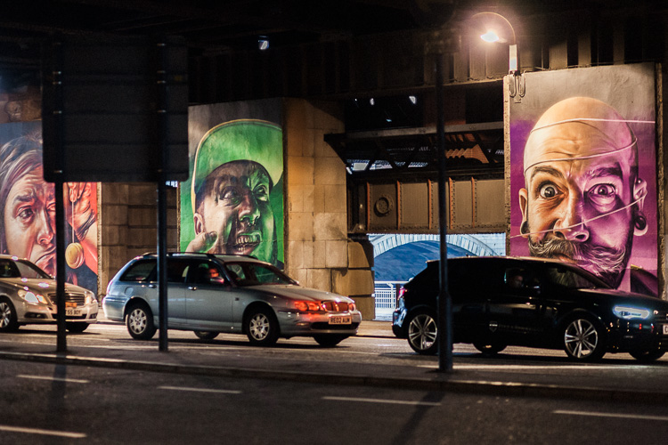 Part of 'The Five Faces', a series of five murals by Smug on the pillars of Caledonian Railway Bridge