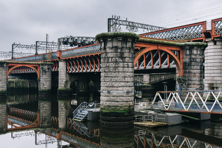 The two bridges - the remains of the first disused Caledonian Bridge in front of the working one that leads into Glasgow Central Station