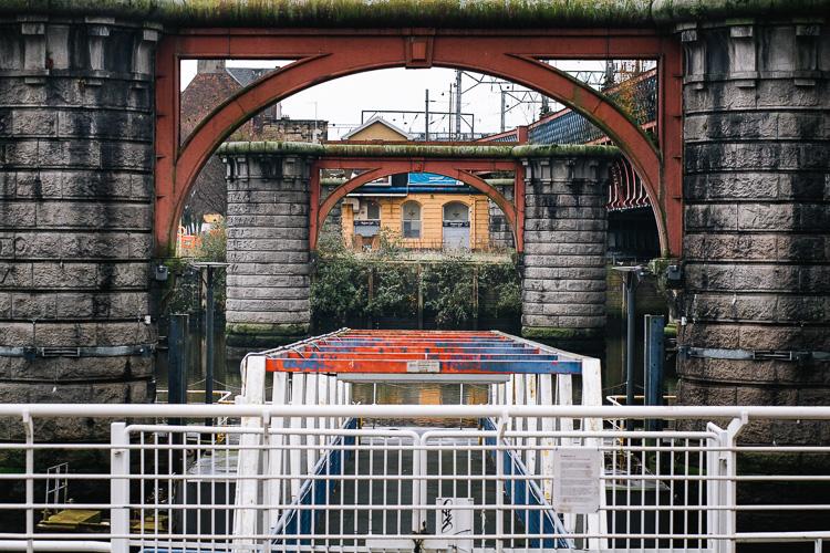 The granite piers of the disused bridge