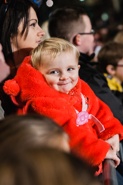 A toddler in the matching outfit from the crowd