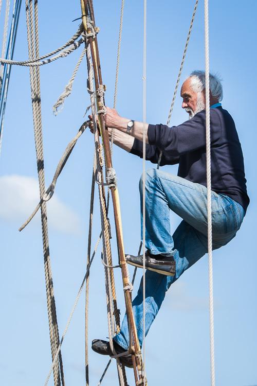 Captain Roy Kerr climbs the rig